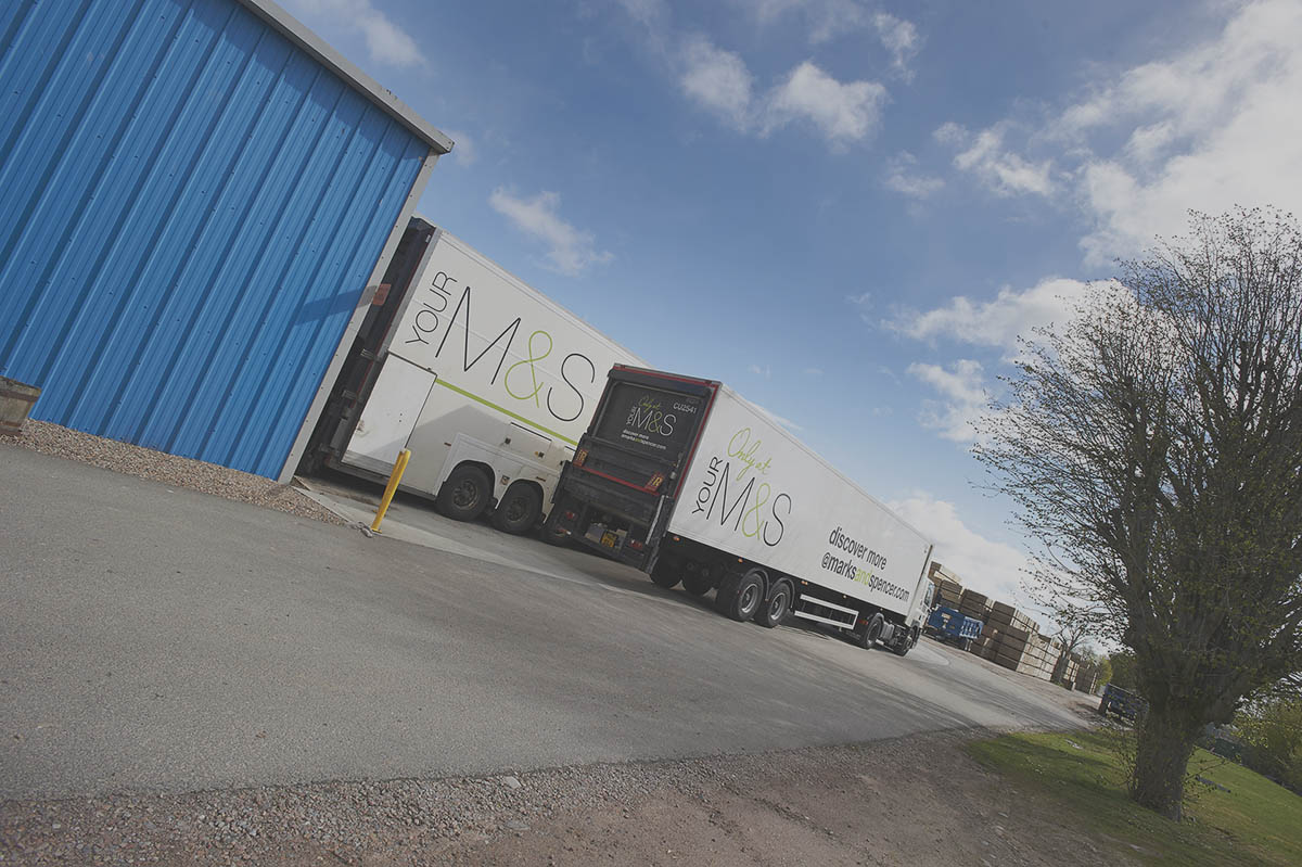 M&S delivery truck collecting produce on site